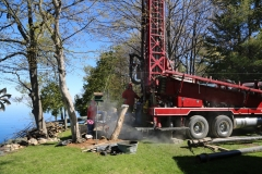 Drilling a well at a home on Lake Champlain